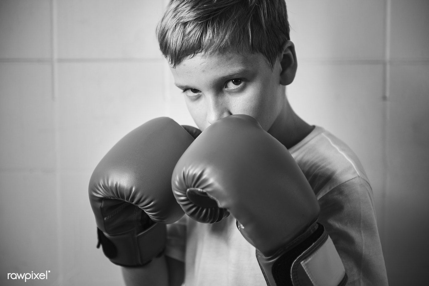 Tough Young Boy In A Boxing Pose