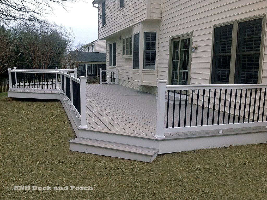 Vinyl Patio Deck With Wide Steps Using Azek PVC Decking Slat Grey Flooring.