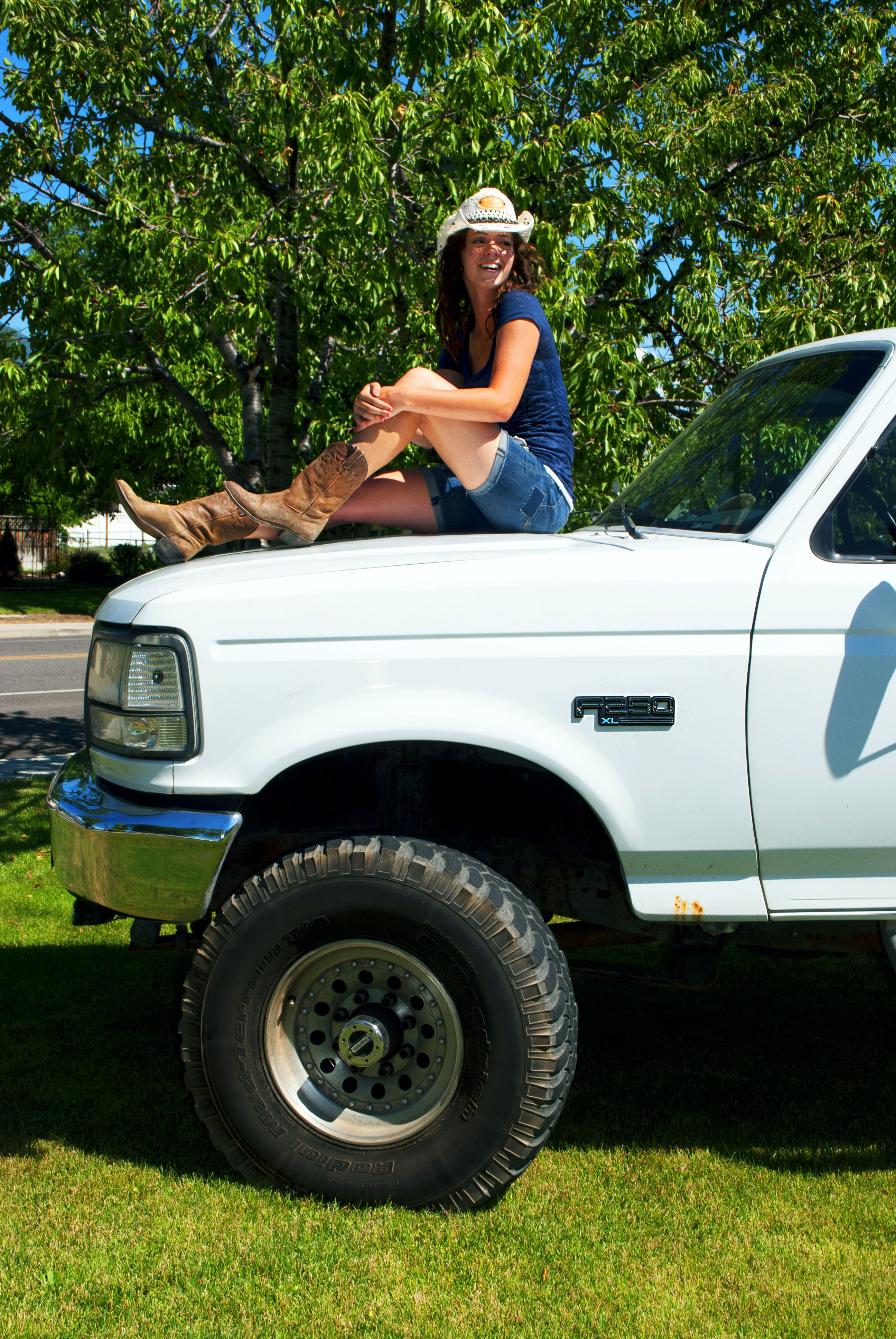 Boots cowgirl on a truck photography