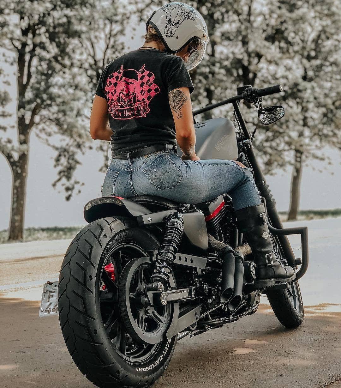 Vans Faria rides a Harley Davidson Sportster motorcycle bike ...