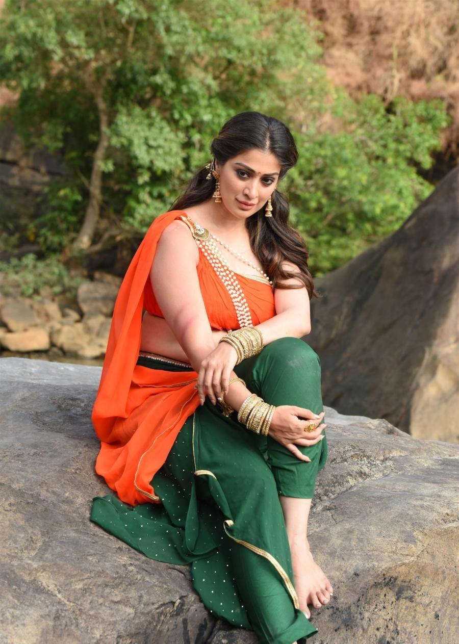 Indian Actress Lakshmi Rai In Green Lehenga Orange Choli | Indian actress  photos, Indian actresses, Indian heroine photo