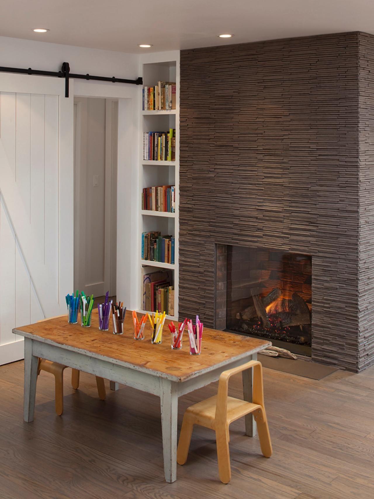 Rough cut porcelain tile surrounds the fireplace and mimics the look fire surround rough cut porcelain tile dailygadgetfo Gallery