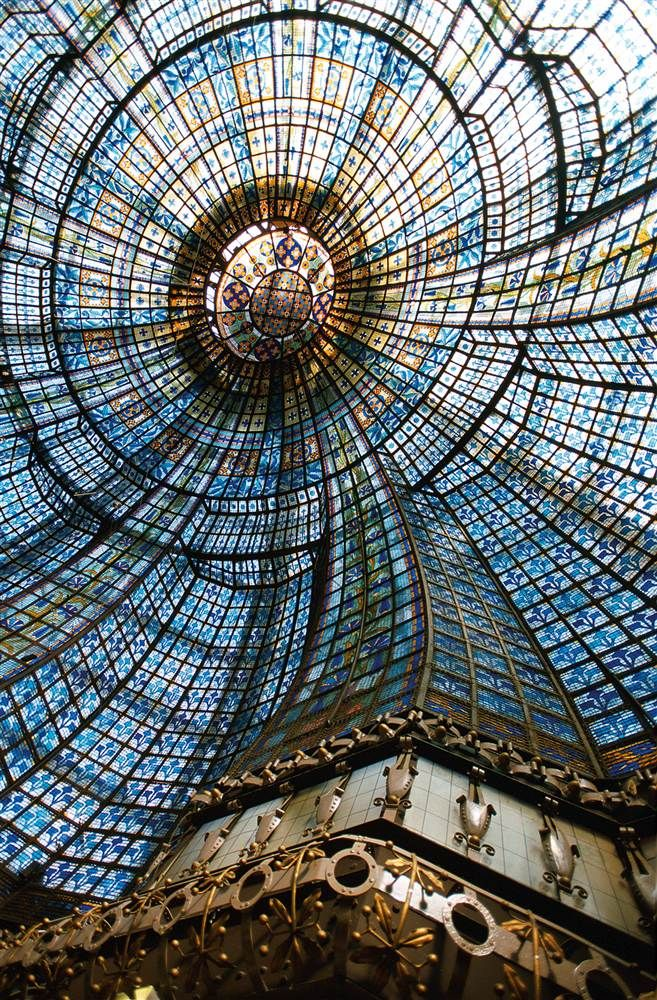 Elaborate stained-glass cupola (dome) inside Magasins du Printemps in Paris
