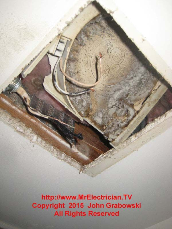 This particular bathroom exhaust fan housing is made of some plastic material.  It broke up very easily for removal.