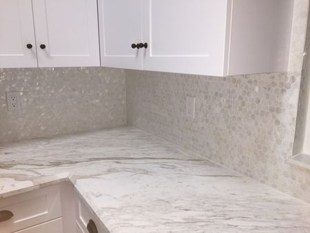 white mother of pearl hexagon tilewhite backsplash tile