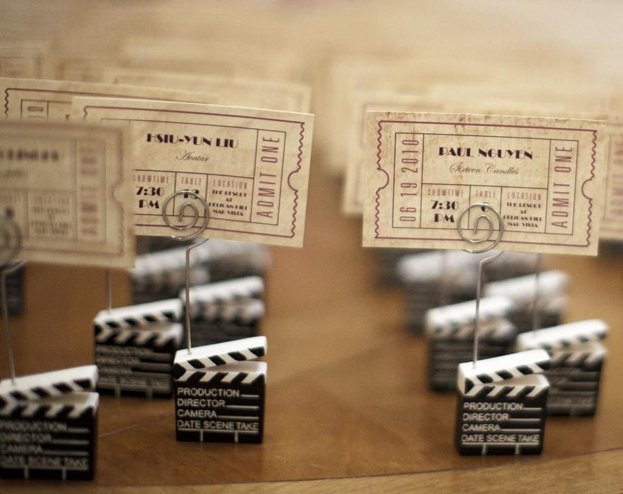 movie ticket escort card.... to tables with  different movie theme