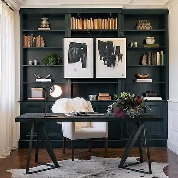 Office With Black Built In Shelves And Black Desk With White Chair