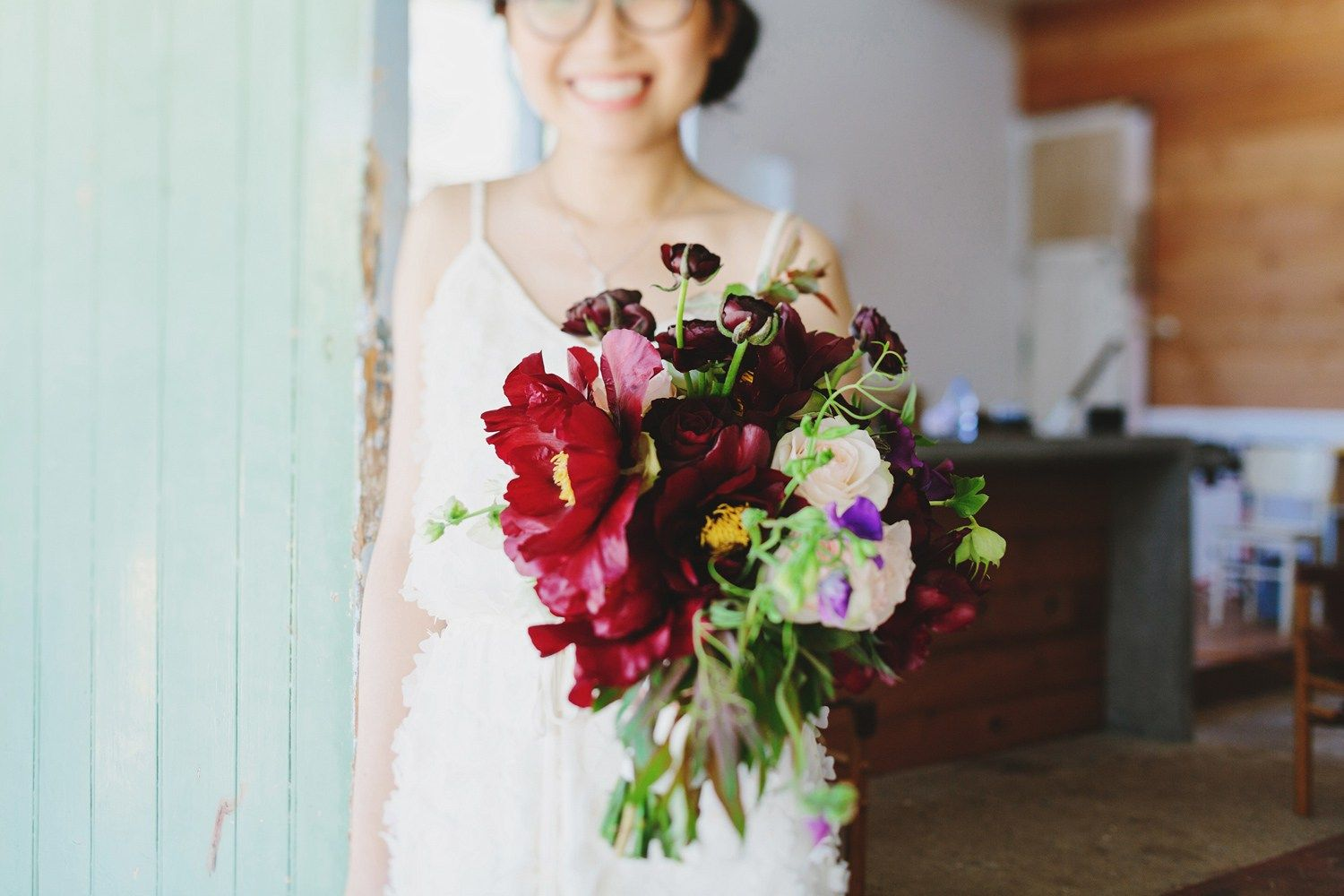 Burgundy wedding bouquet included peonies, garden roses, deep plum lilacs, sweet pea and jasmine vine | fabmood.com #weddingbouquet #rusticwedding #factorywedding