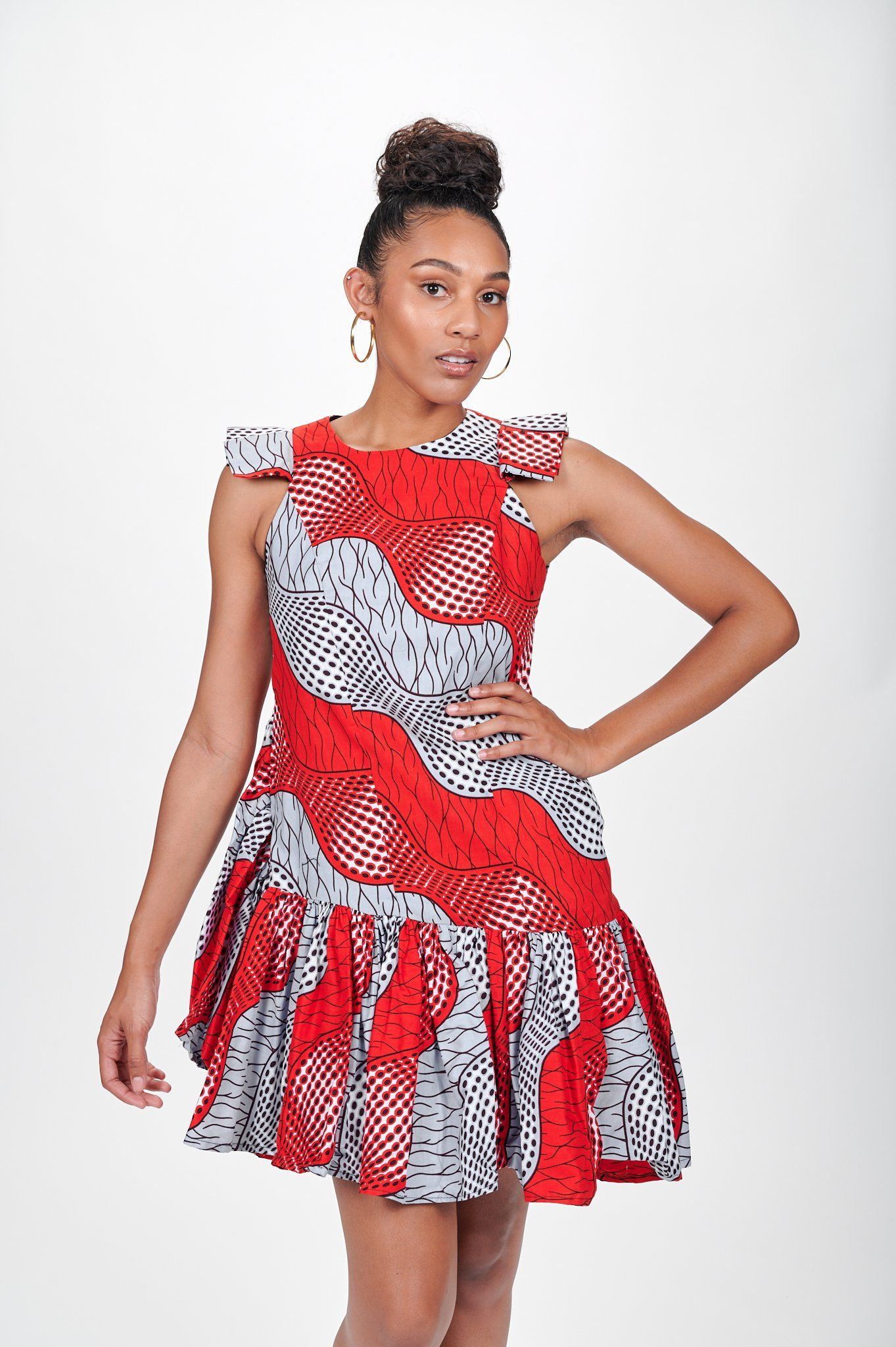 This African print dress is handmade with beautiful Ankara fabric and is effortless cute yet sexy. Dress it down with flat sandals/sneakers or dress it up with a pair of high heels and a belt to accentuate the waistline. 100% cotton wax Right-sided slanted neckline, right-sided off-shoulder/ left-sided cold shoulder A line puff sleeves with elastic self-tie belt 37 inches long Lined