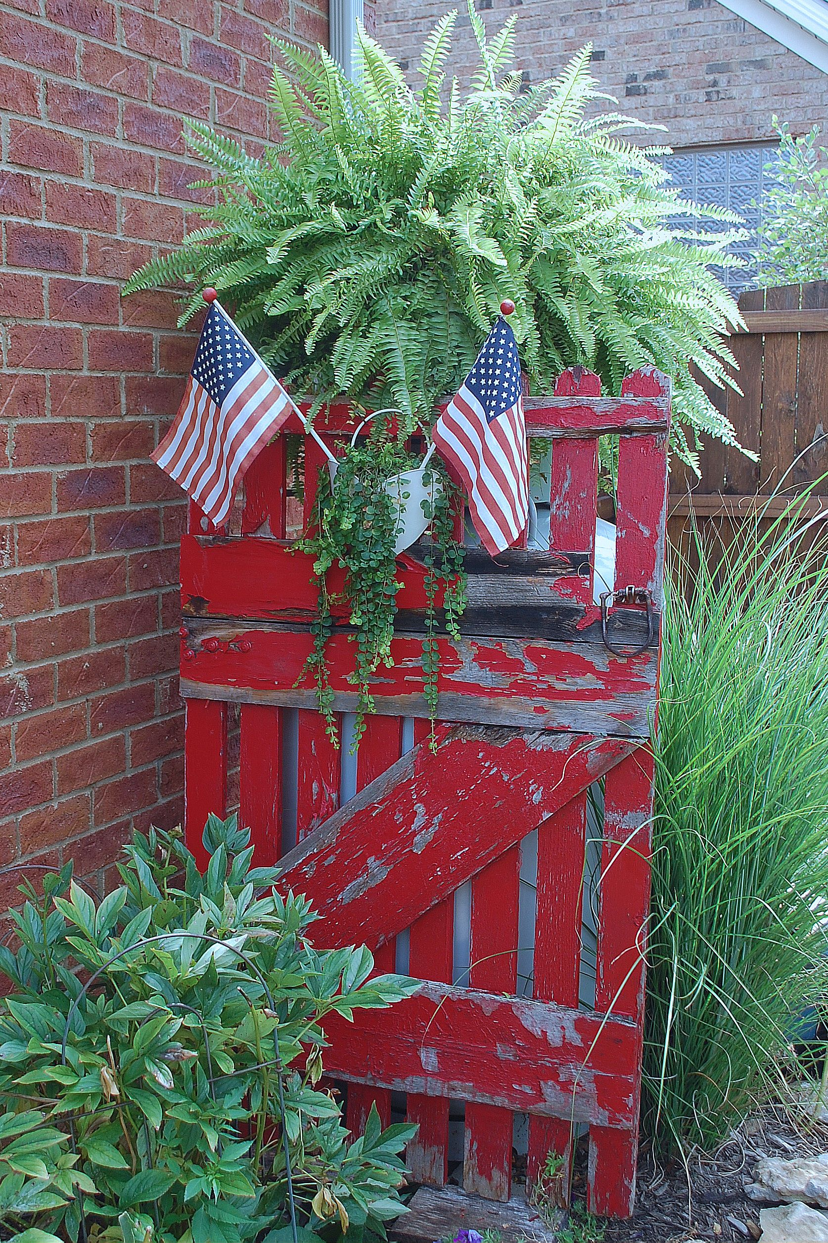 Used an old gate to cover up our upright propane tank garden ideas pinterest gate gardens - Garden ideas to hide fence ...