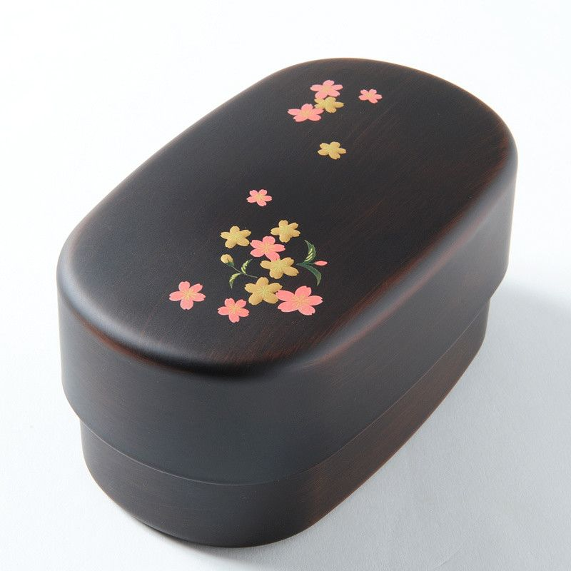 A delicious meal can be the highlight of one's day, and bento culture is all about making meals an enjoyable experience. With this bento box you'll be able to prepare your own bento to look forward to eating, and it has two tiers so it's easy to prepare and organize a variety of food! The box is black with cherry blossoms and komachi (a rice plant) painted on it. It's also safe to use in the micro...