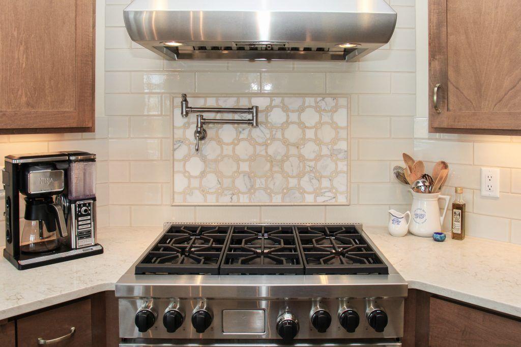 beige glossy tile backsplash white and