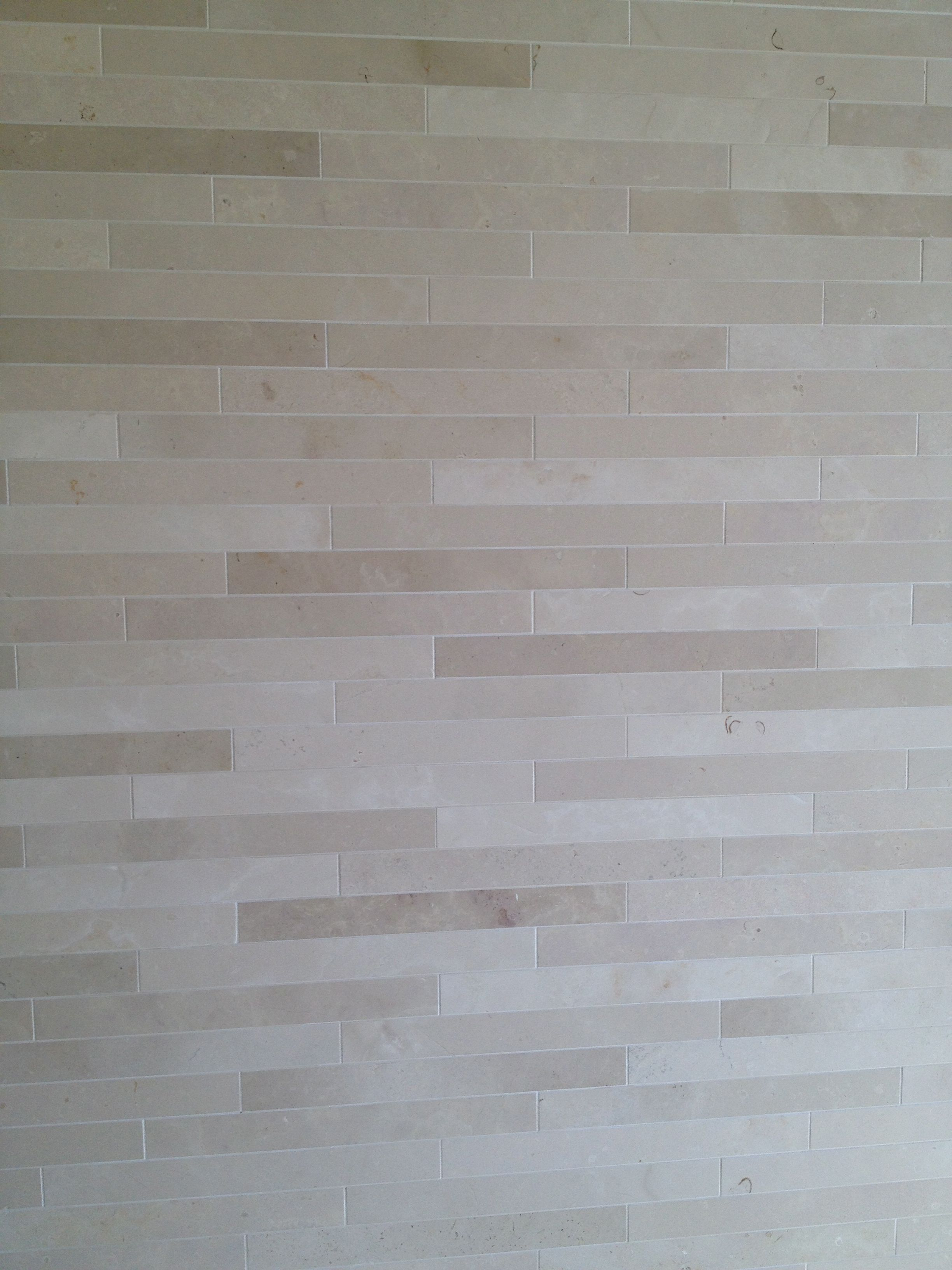 natural stone tile in a long format creates a luxurious feel in your ...