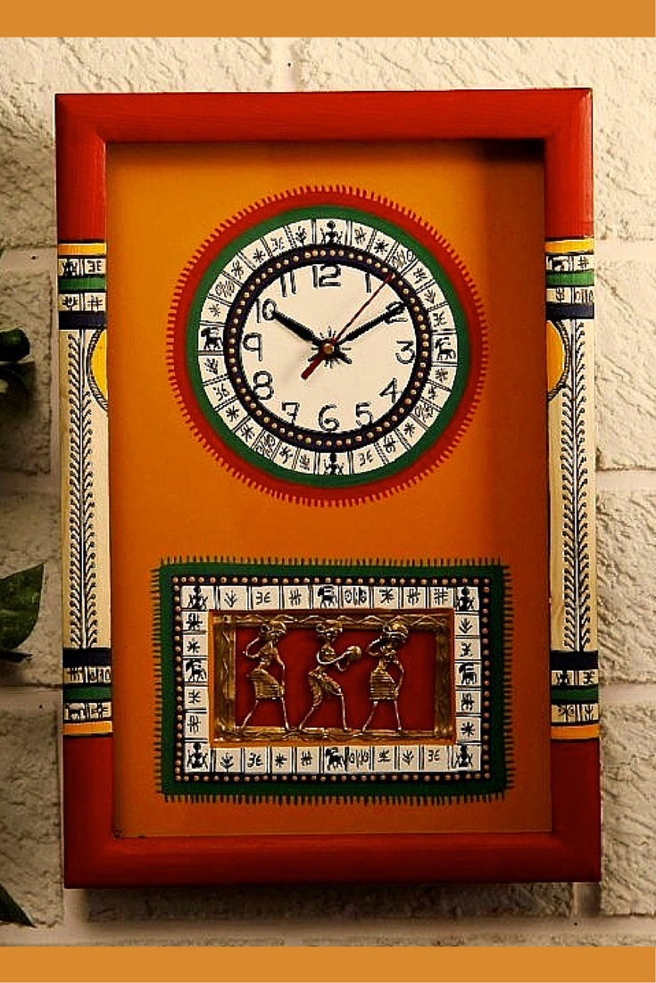 This clock fuses two art forms, the Warli tribal art from Maharashtra and the Dhokra or lost wax casting from Bastar, to augment its appeal. It is mounted on a wooden board and painted in bright red and yellow. All this makes this clock the perfect one for your drawing room.