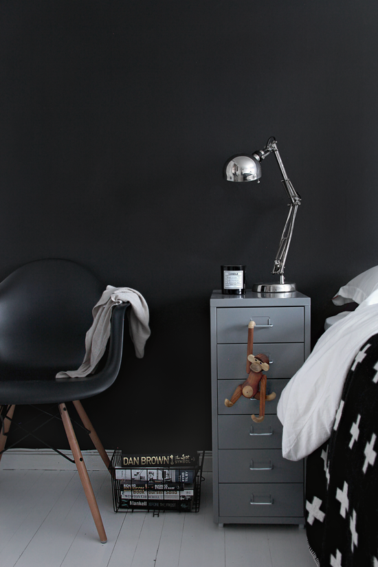I love everything in this picture: the nightstand, night lamp, the chair, dark coulours, bedding. AMAZING