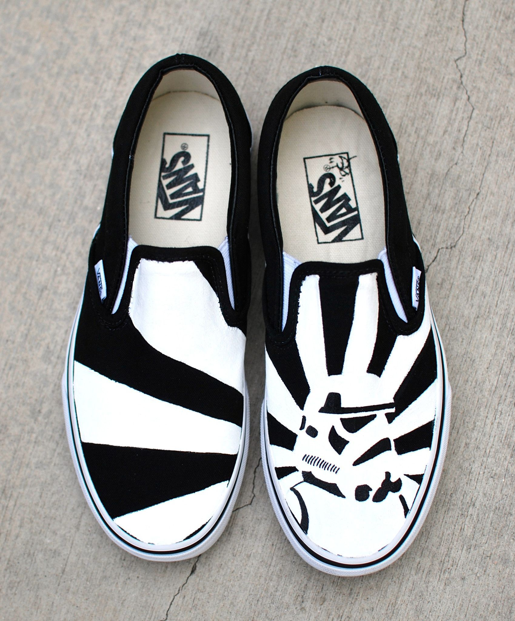 b4a9ebce27 These one-of-a-kind hand-painted Vans Slip ons Feature a black and white storm  trooper on one shoe and the rising sun behind him.