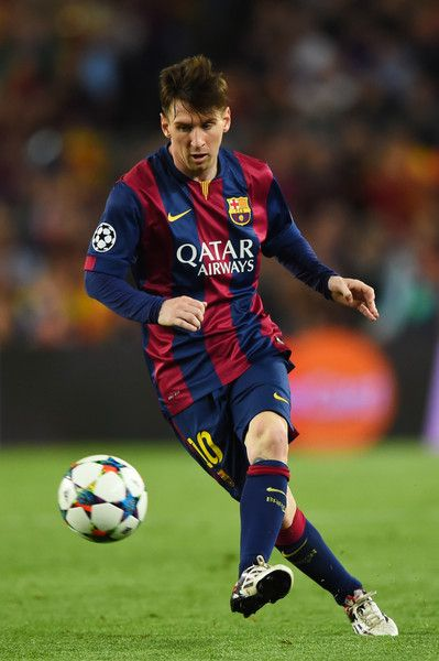 Lionel Messi of Barcelona passes the ball during the UEFA Champions League Semi Final, first leg match between FC Barcelona and FC Bayern München at Camp Nou on May 6, 2015 in Barcelona, Catalonia.