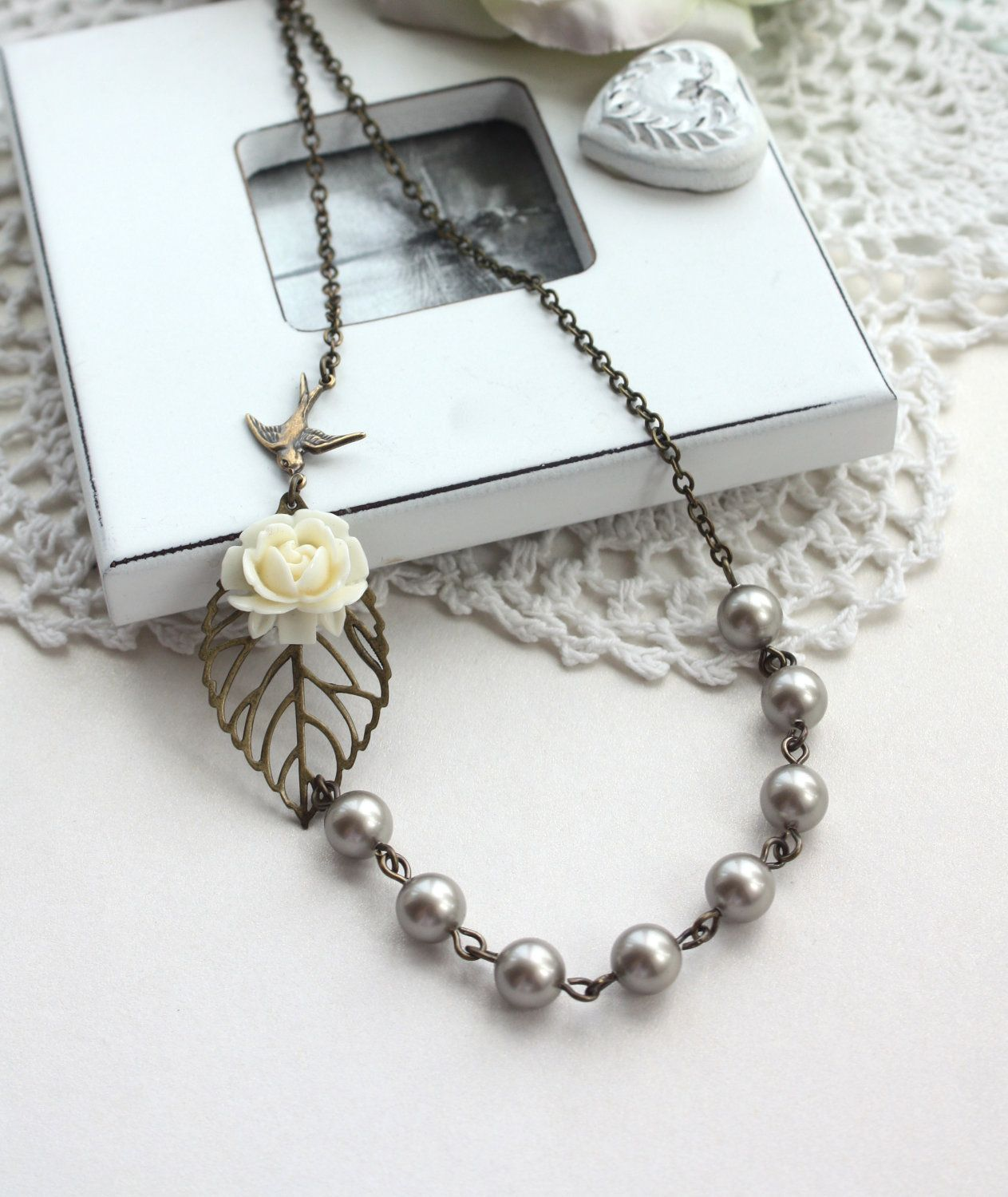 An Ivory Rose Flower, Leaf, Flying Swallow Bird, Platinum, Dark Grey Pearl Necklace. Vintage Bride. Bridesmaid Necklace. Wedding Gifts.. $29.50, via Etsy.
