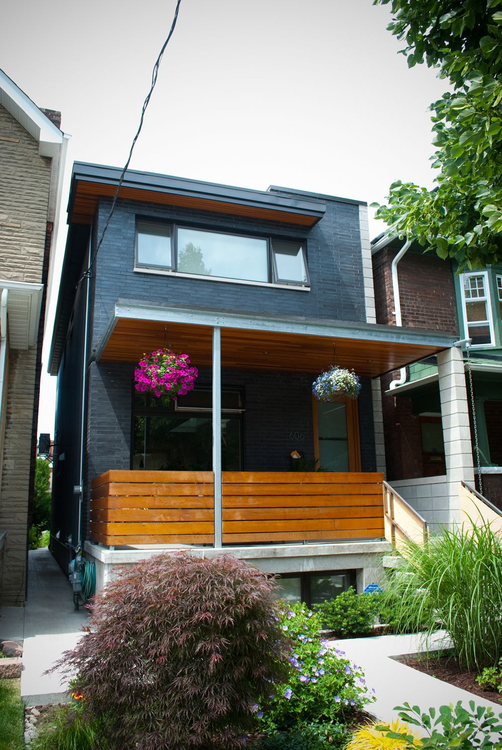 The best sustainable woods for exterior siding and decking - Modern Wood Front Porch Love The Contrast Of Wood And The Dark Exterior Modern