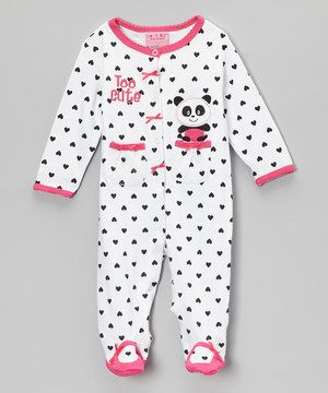 Adorned with an adorable appliqué and fun print, this snuggly all-cotton footie will prep little ones for comfy travels to dreamland. Handy snap buttons along the front and both legs make late-night diaper changes a breeze.