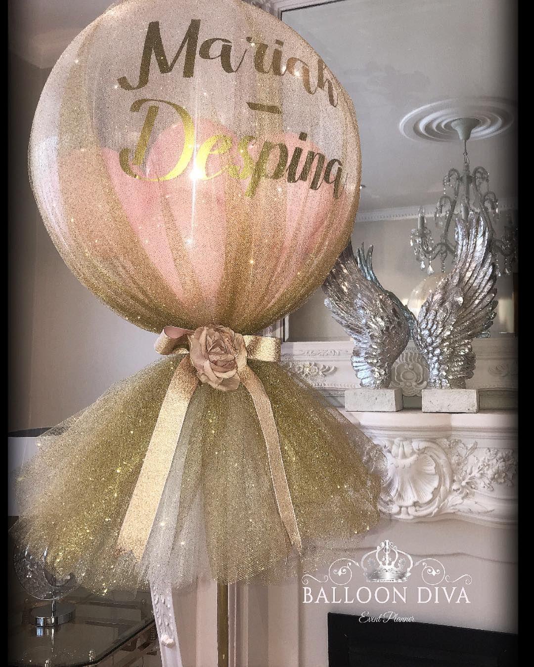 Image may contain indoor Balloons, Balloon centerpieces