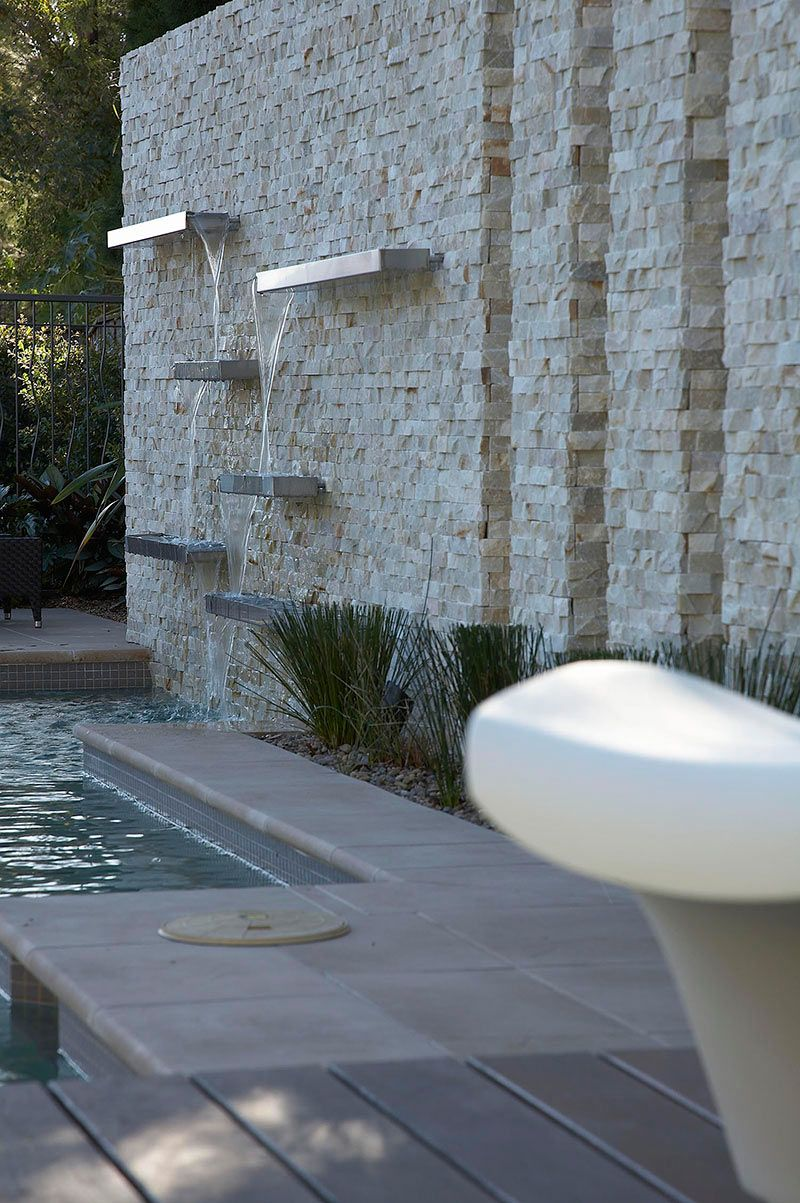 53 Cool Backyard Pond Design Ideas: This Waterfall Could Mask Traffic Noise And Look Great Lit
