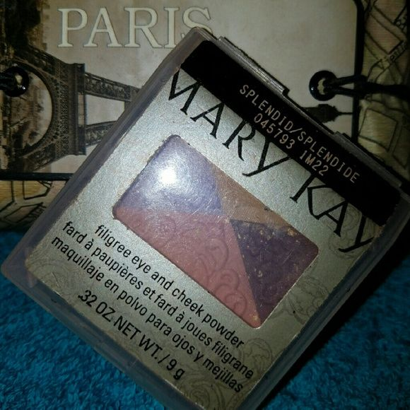 Mary Kay eye and cheek powder Purples, pinks, and bronzy golds for that nice spring and summer look. Shades for eyes and cheeks with flecks of gold. Contains 3 eye colors and 1 cheek color. The light purple is slightly used along with the gold. Mary Kay Makeup