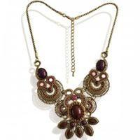 Bronskleurige halsketting met rode en paarse strass voor maar 8,95 bij www.deoorbel.nl