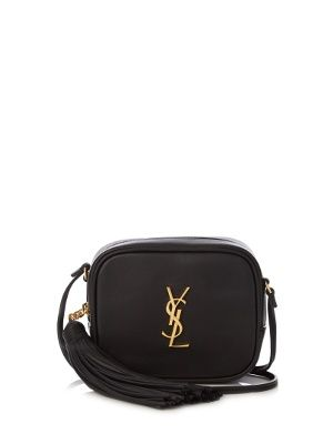 a6a89630cfb5 It s crafted from black leather that s punctuated with iconic gold-tone YSL  lettering