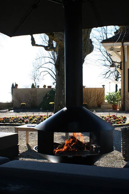 A new concept for a cover protected,all weather fireplace and BBQ in one.