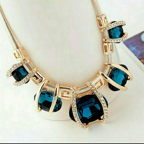 LARGE BLUE GEM STATEMENT NECKLACE Gold necklace with large blue gems and small white crystals. It's gorgeous! Boutique  Jewelry Necklaces