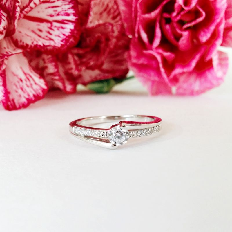 This Valentine's Day make her a promise as beautiful as she is with this petite brilliant cut CZ promise ring. This lovely sterling silver ring features a band with side CZ stone accents and is sure to delight.