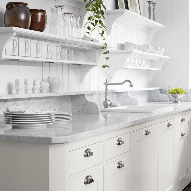 Stacked Oak Floating Shelves Are Mounted To White Herringbone