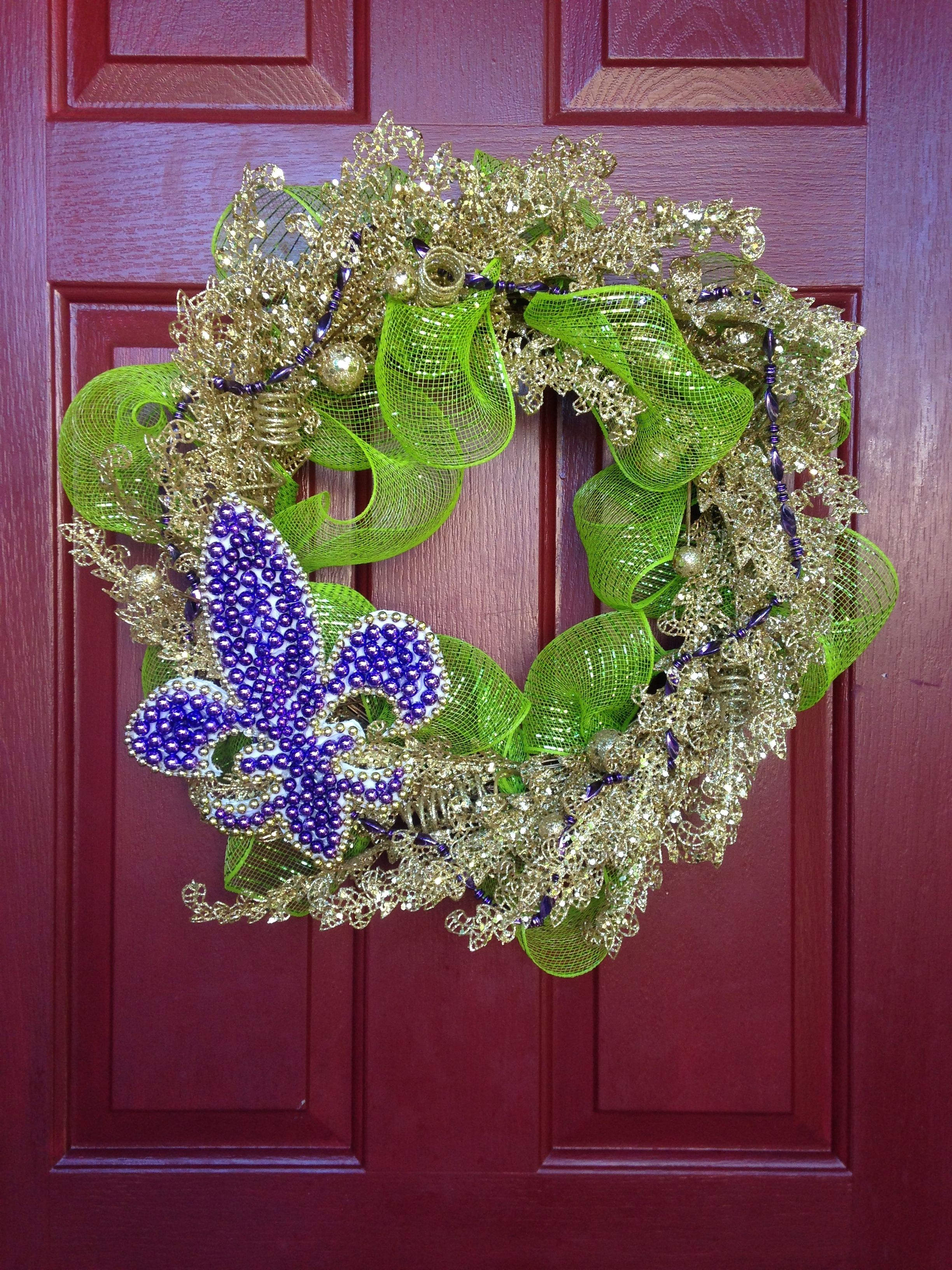 a gaudy gold wreath on christmas clearance at home depot paired with green mesh - Home Depot Christmas Clearance