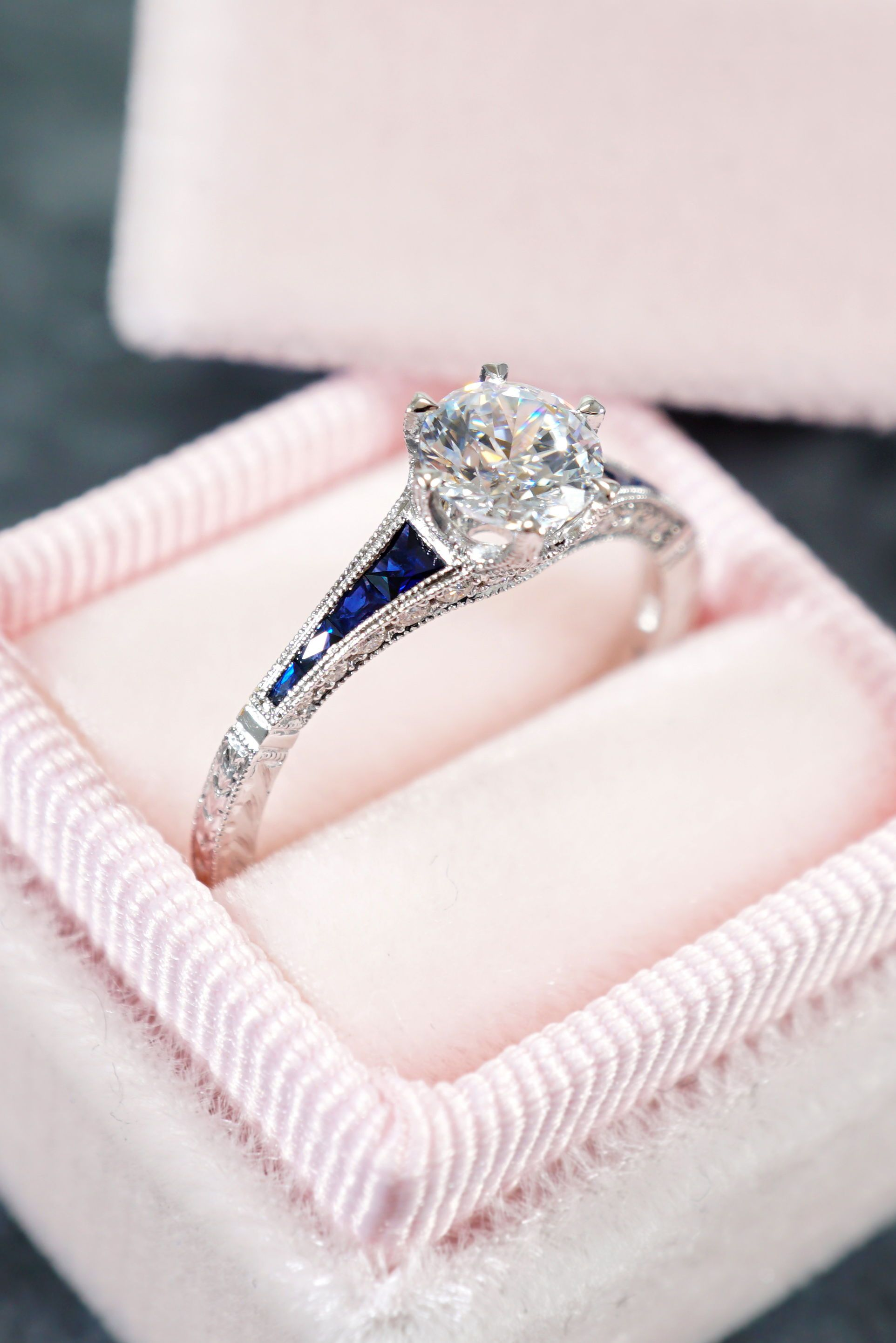 91c79d4557b This gorgeous engagement ring features a round brilliant cut diamond in a  six prong setting at the top of a narrow white gold shank