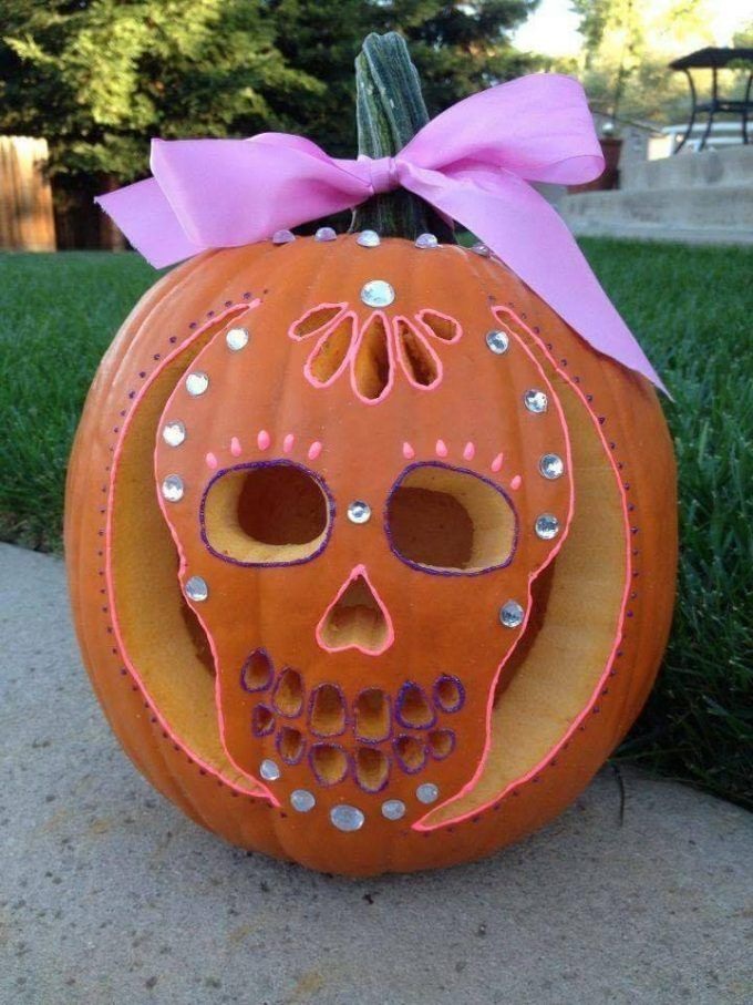 Sugar skull pumpkin with rhinestones...so cute! #pumkincarvingdesigns
