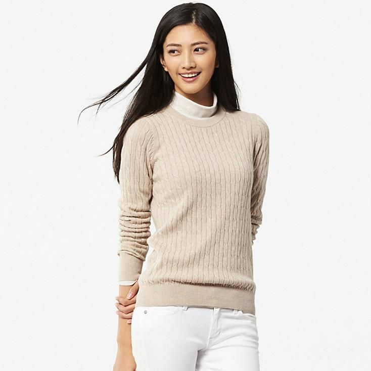 This lovely women's sweater blends the soft comfort of cotton with the  elegant texture of cashmere. The trendy cable knit design gives it a  refreshing look, ...
