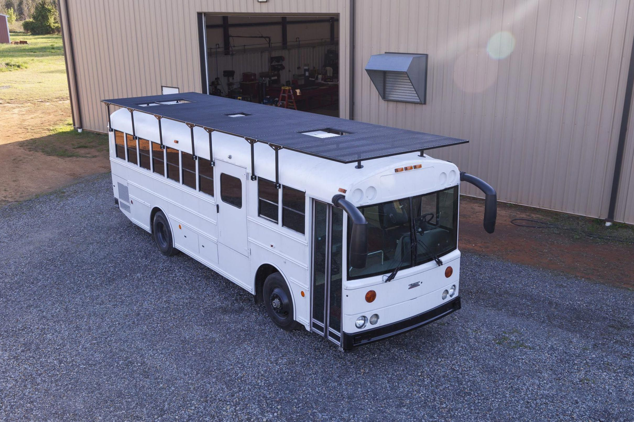 Solar Powered School Bus Home Makes A Modern Mobile Home Curbed Solarenergy Solarpower Solarinstallation Solarelectricity Converted Bus Bus House School Bus