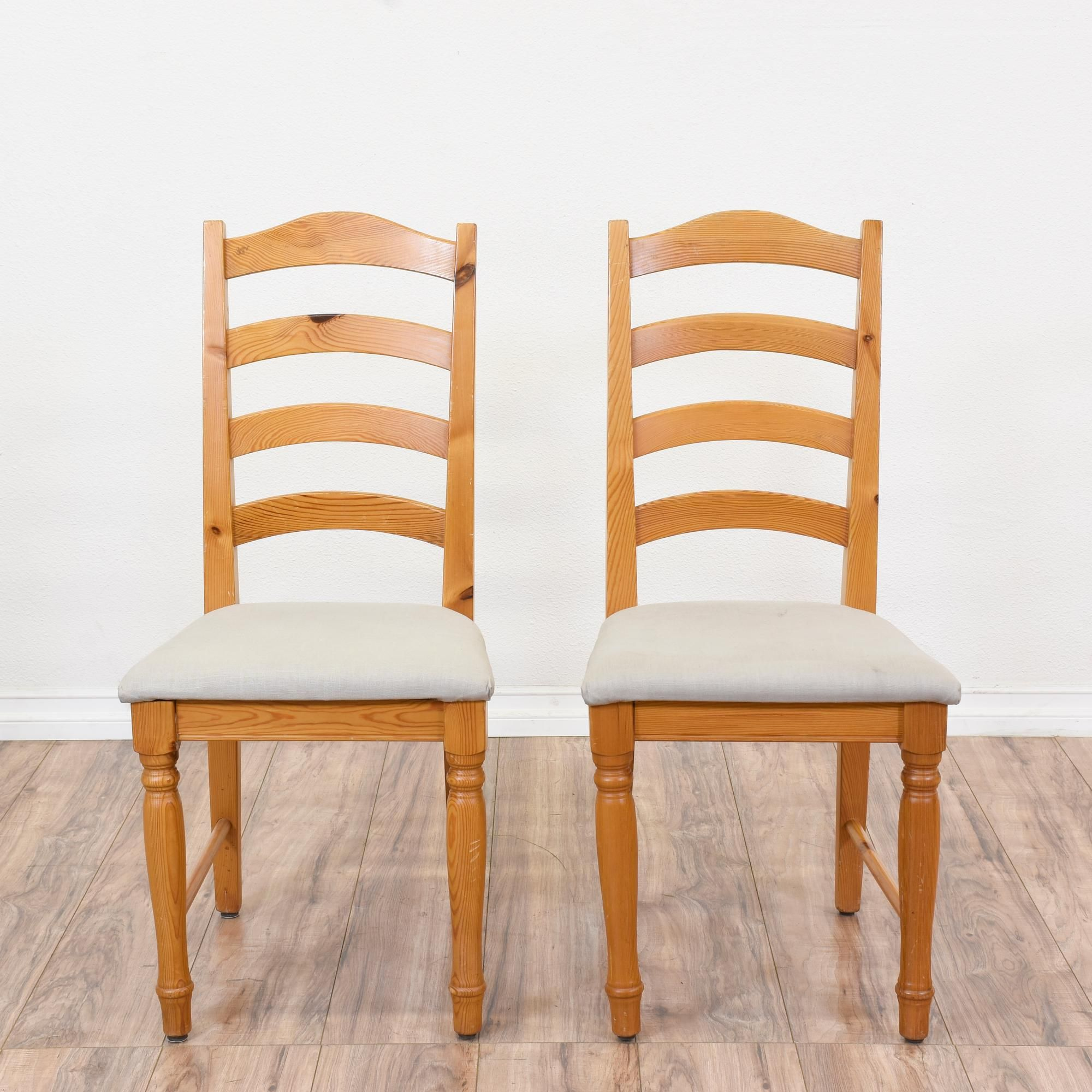 This Pair Of Ladder Back Chairs Are Featured In A Solid Wood With A Glossy  Pine