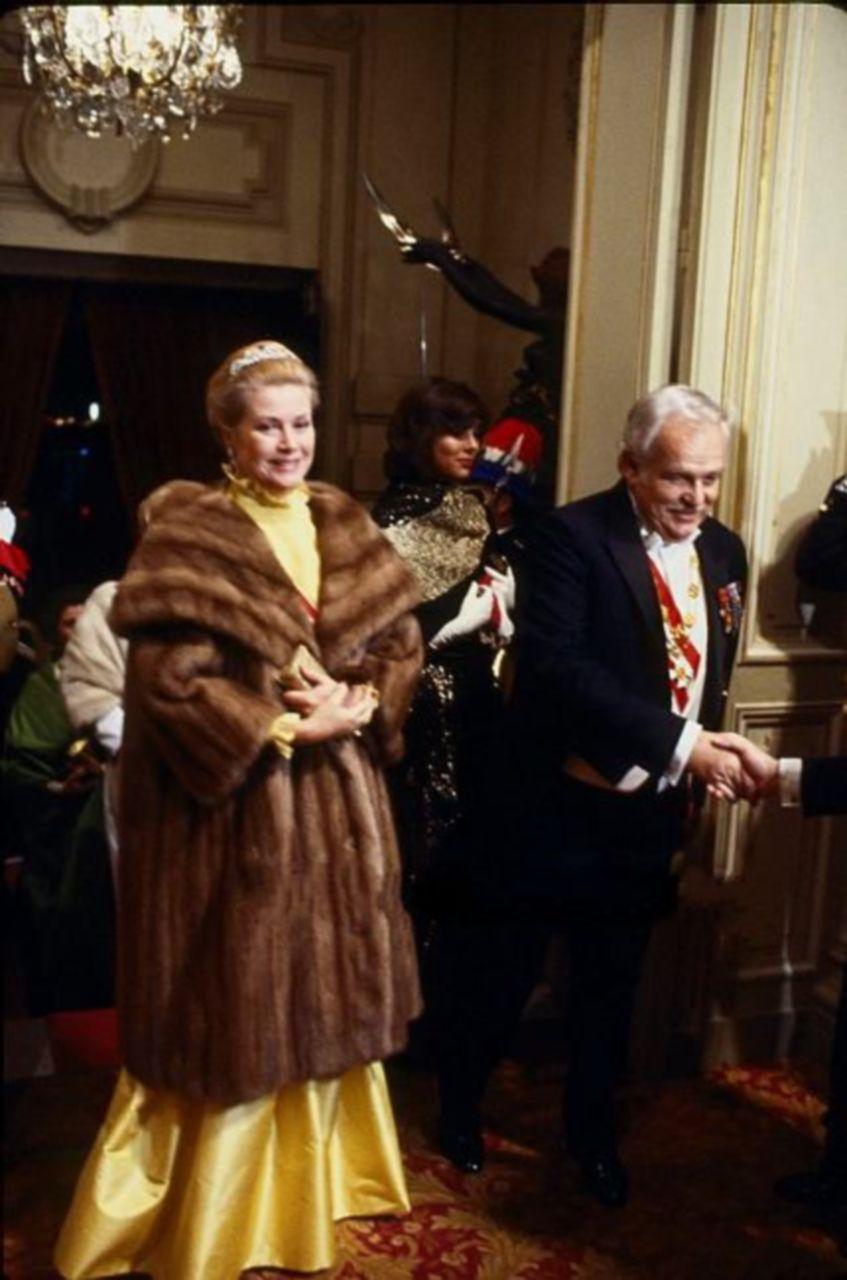 Prince Rainier and Princess Grace of Monaco with Princess Caroline (behind) — Monaco National Day Celebrations, Nov. 19, 1981.