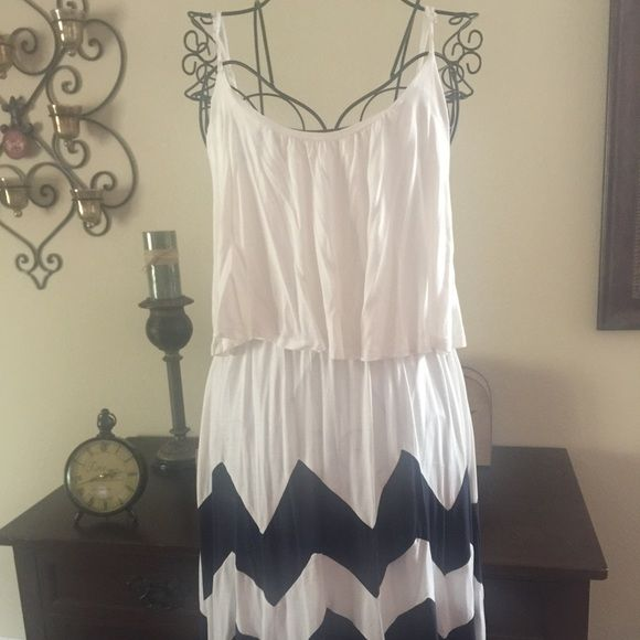 Adorable Brand-new summer dress . Blue-and-white nautical  summer dress new without tags's hits Mid knee and is longer in back has a cute diamond shape opening in back. Says XL but fits like a L Dresses Midi