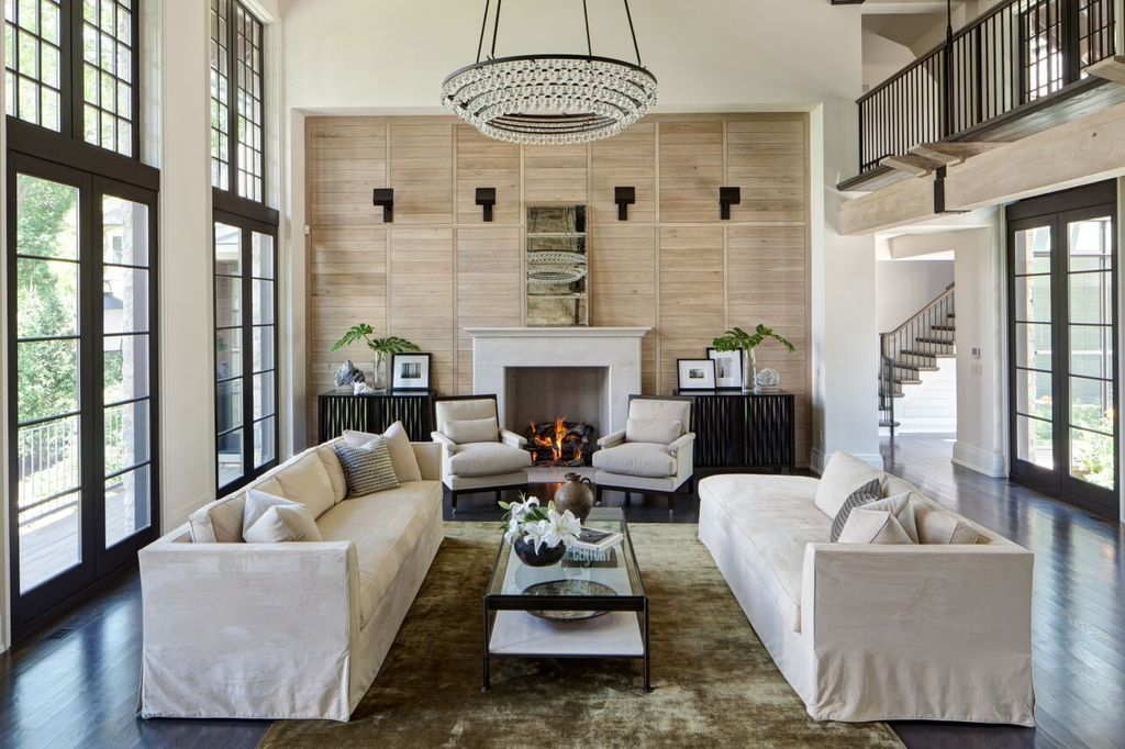 Traditional Living Room With Carpet High Ceiling Cement Fireplace Balcony Hardwood Floors