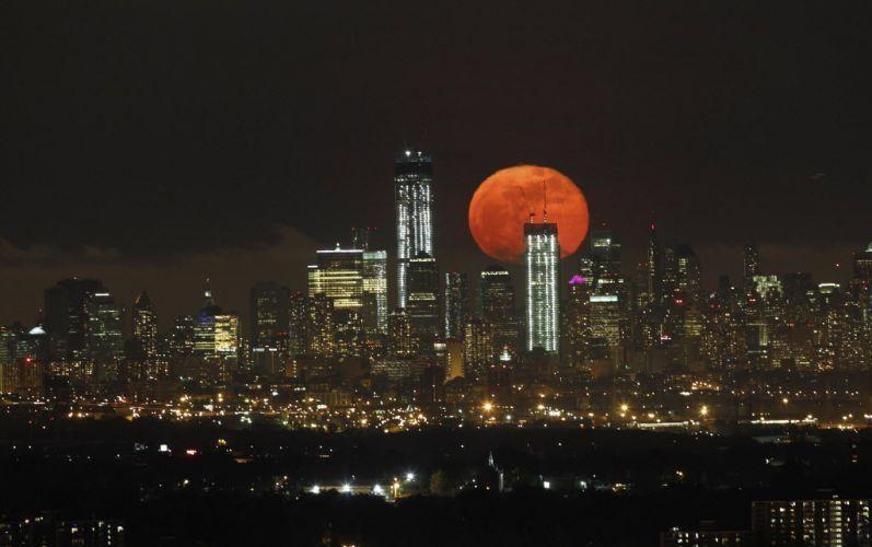 new york skyline over an orange moon
