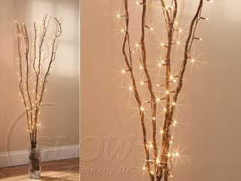 Using Decorative Twigs And Twirling Fairy Lights Round Creates A Nice Effect Would Look Good In A Woodlan Scene Decor Twig Fairy Lights