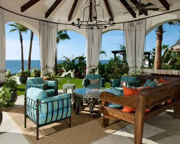 gazebo decorating with outdoor furniture and blue cushions