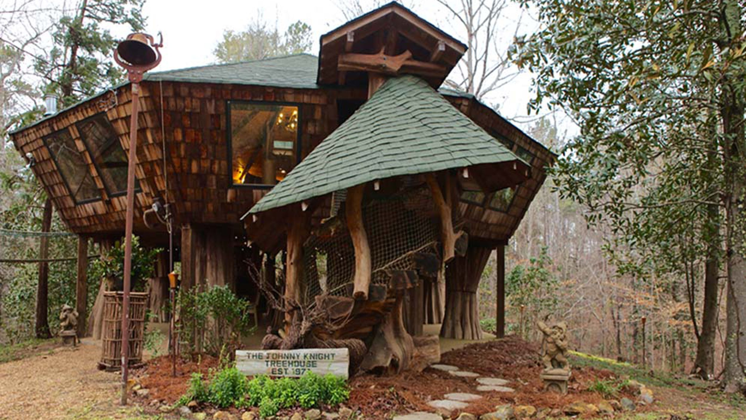 The Ultimate Place To Play See Inside This 1 200 Square Foot Tree House Tree House Cool Tree Houses Tree House Designs