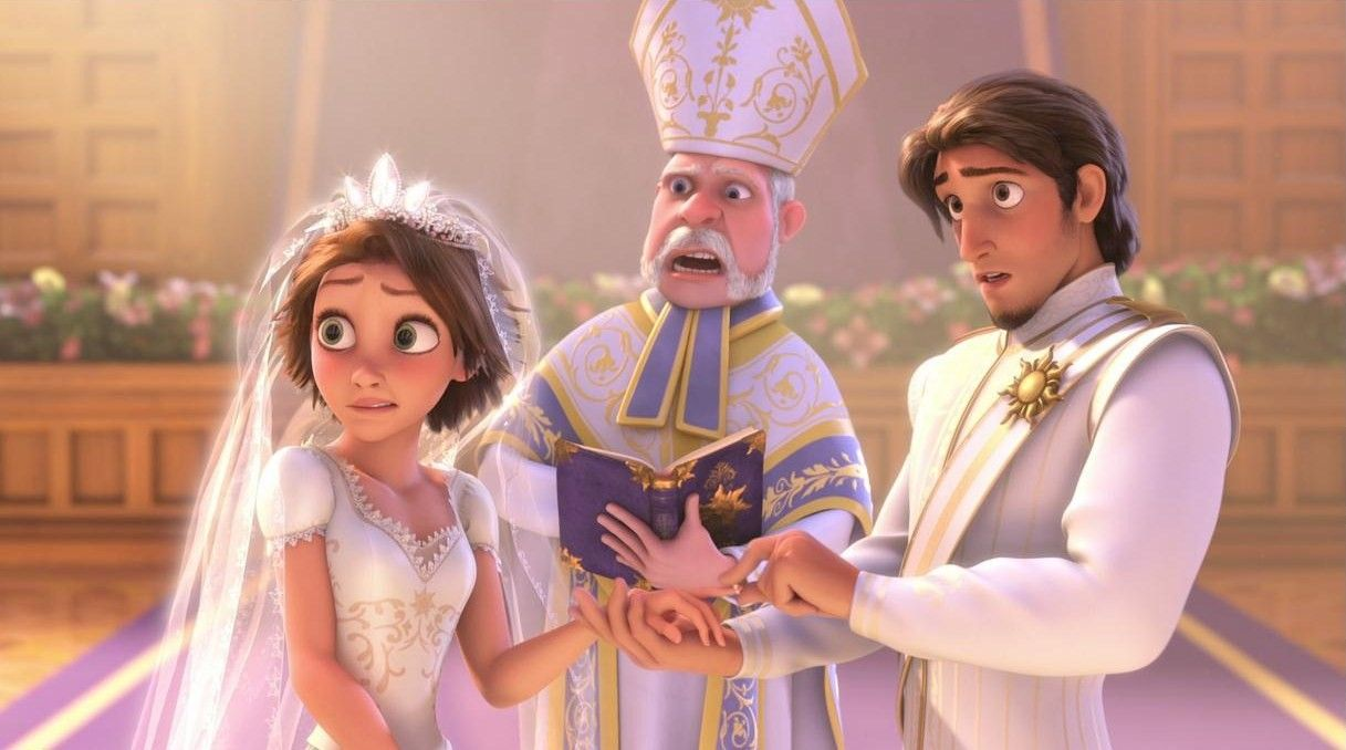 Rapunzel and Flynn Rider placed their wedding rings on their finge ...