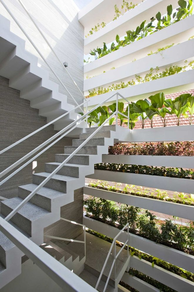 """This """"Stacking Green"""" house built in the noisy, polluted, & densely populated city of Saigon uses green construction, facade planters & a rooftop garden to protect its inhabitants from direct sunlight, street noise and pollution."""