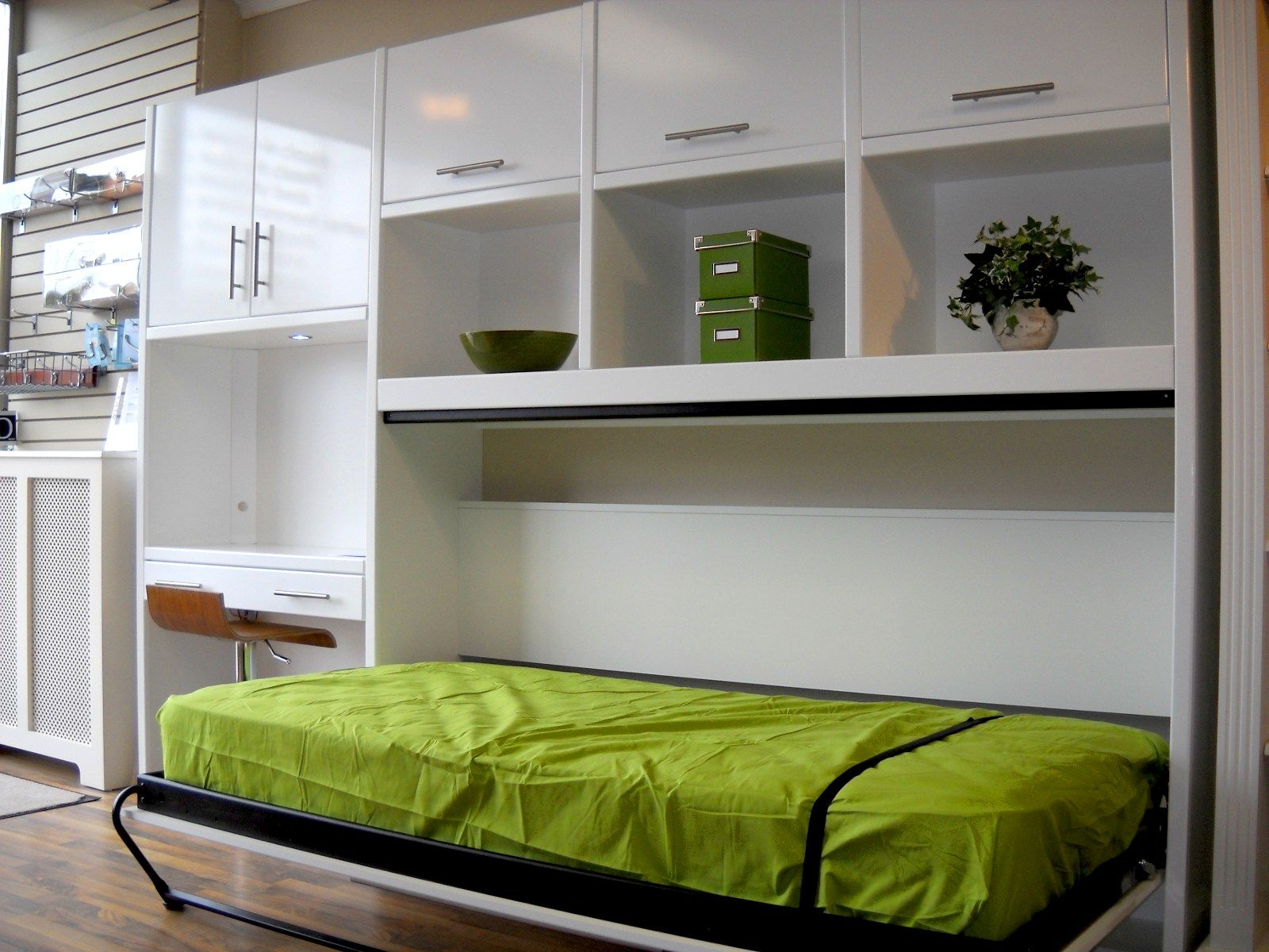 Bedroom. Glossy White Murphy Bed With Green Quilt On The