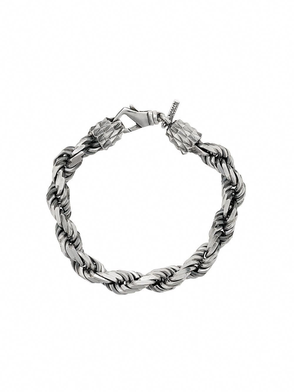 This twice tress strip band features semi-precious faceted
